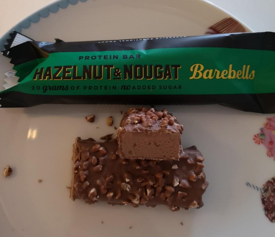 Op deze foto de smaak Hazelnut & Nougat van de barebells repen