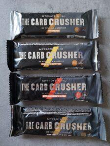 Op deze foto zie je 4 eiwitrepen van de THE Carb Crusher