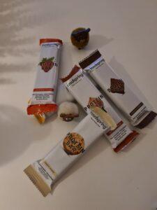 Op deze foto zie je alle smaken Protein Bars van foodspring