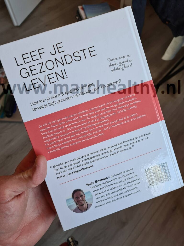 Op deze foto zie je het Koolhydraatarm 50 Dagen Programma boek achterkant